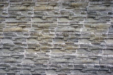 Detail of a stone wall with one size of rock photo