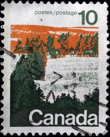 CANADA - CIRCA 1980s: A stamp printed in Canada shows winter forest, circa 1980s  photo