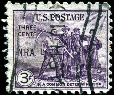 devoted:  UNITED STATES OF AMERICA - CIRCA 1940s: A stamp printed in the United States devoted in common determination shows four men, circa 1940s