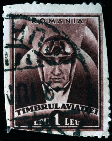vj: ROMANIA - CIRCA 1950s: A stamp printed in Romania shows pilot with goggles on the helmet, circa 1950s
