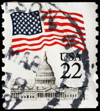 UNITED STATES OF AMERICA - CIRCA 1985: A stamp printed in the USA shows flag over capitol, circa 1985 Stock Photo - 7810834