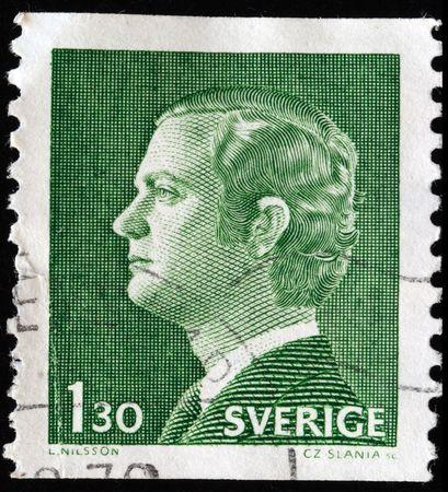 king carl xvi gustaf:  SWEDEN - CIRCA 1970: A stamp printed in Sweden shows king Carl XVI Gustaf , circa 1970  Editorial