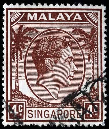 malaya: MALAYA - SINGAPORE CIRCA 1940s:A stamp printed in United Kingdom for Malaya and Singapore shows King George VI, circa 1940s Stock Photo