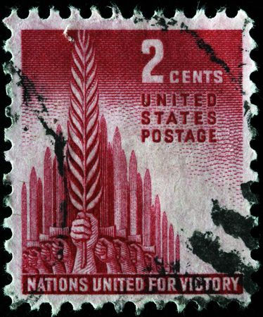 UNITED STATES OF AMERICA - CIRCA 1941: A stamp printed in the United States of America devoted United nations for defence under Hiltler, circa 1941 Stock Photo - 7839518