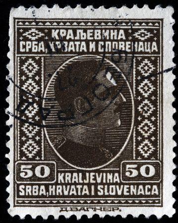 KINGDOM OF SERBIA, CROATIA AND SLAVONIA - CIRCA 1924: A stamp printed in Kingdom of Serbia, Croatia and Slavonia shows king Alexander I of Yugoslavia, circa 1924  Stock Photo - 8163207