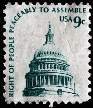 peaceably: USA - CIRCA 1977. Postage stamp of right of people peaceably to assemble printed in USA shows building of Congress, circa 1977