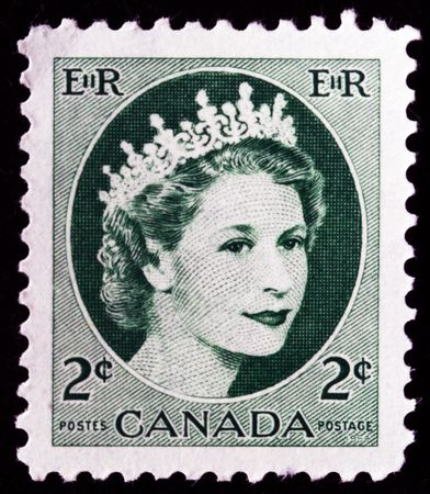 canada stamp: CANADA - CIRCA 1954: A stamp printed in Canada shows Queen Elizabeth II, circa 1954  Editorial