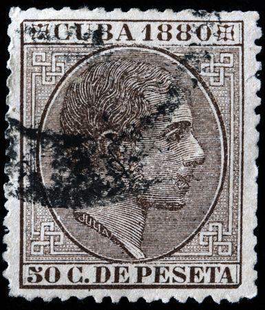 pio: CUBA - CIRCA 1880: F stamp printed in Cuba shows Alfonso XII of Spain (born Alfonso Francisco de Asis Fernando Pio Juan Maria de la Concepcion Gregorio Pelayo) from family de Borbon Editorial