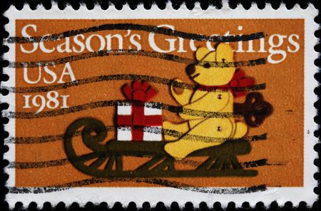 UNITED STATES - CIRCA 1981 : A stamp printed in United States. Teddy Bear on Sled Christmas Issue. United States - CIRCA 1981 photo