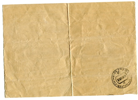 telegram: downside of an old weathering  telegram bearing the stamp of post office isolated on white background