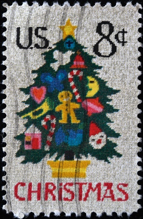 UNITED STATES OF AMERICA - CIRCA 1975: A stamp printed in the USA shows Christmas Tree, circa 1975 Stock Photo - 8240291