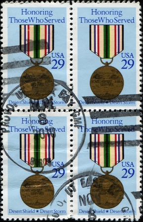 postman of the desert: UNITED STATES OF AMERICA - CIRCA 1979: A stamp printed in the USA shows Desert Storm Medal, circa 1979 Stock Photo