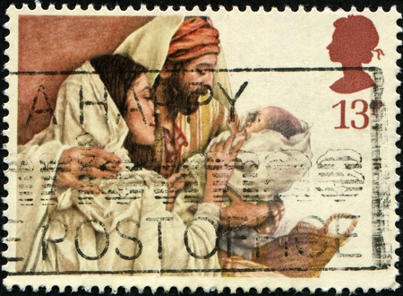 UNITED KINGDOM - CIRCA 1984: A British Used Christmas Postage Stamp showing Mary, Joseph and Jesus, circa 1984  Stock Photo - 8330159