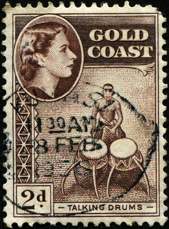GOLD COAST - CIRCA 1952: A stamp King George VI talking drums pictorial printed in Gold Coast, circa 1952 photo