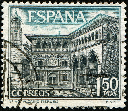 SPAIN - CIRCA 1937: A stamp printed in Spain shows Building City Hall (16 century) and the Mercantile Exchange (15 century) in Alcañiz, circa 1937 Standard-Bild