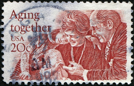 UNITED STATES - CIRCA 1982: A stamp printed in United States, shows eldery peoples with childs, circa 1999 photo