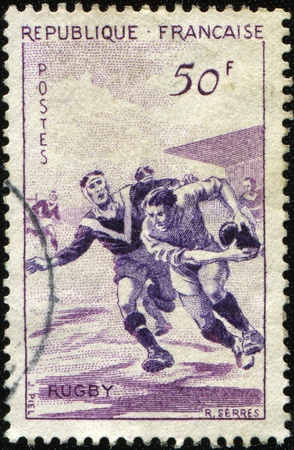 FRANCE - CIRCA 1959: A stamp printed in France shows i rugby players, circa 1959