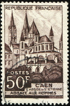 postage stamp: FRANCE - CIRCA 1951: A stamp printed in France shows Abbaye-aux-Hommes in the French city of Caen, Normandy, circa 1951