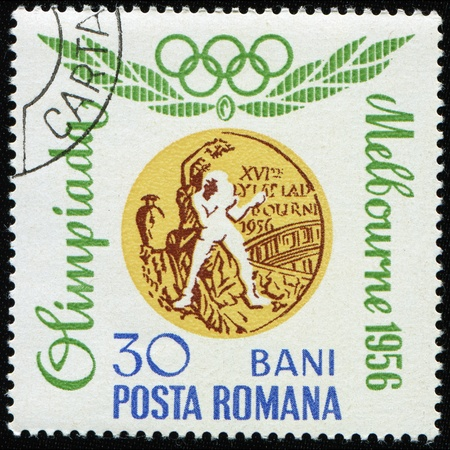 ROMANIA - CIRCA 1960: A stamp printed in Romania shows Gold medal for boxing, one stamp from series devoted to the Olympic Games in Roma, circa 1960