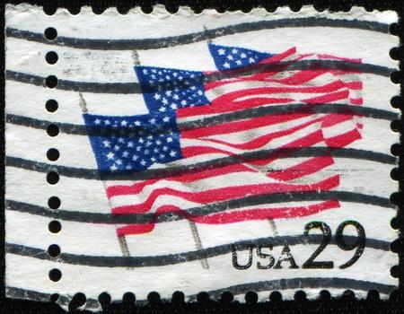 UNITED STATES OF AMERICA - CIRCA 1991: A stamp printed in the United States of America shows Flags on Parade, circa 1991 photo