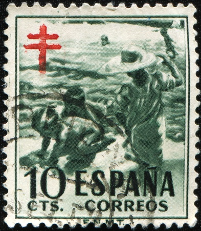 philatelic: SPAIN - CIRCA 1946: A stamp printed in Spain shows image of people bathing, series, circa 1946  Stock Photo