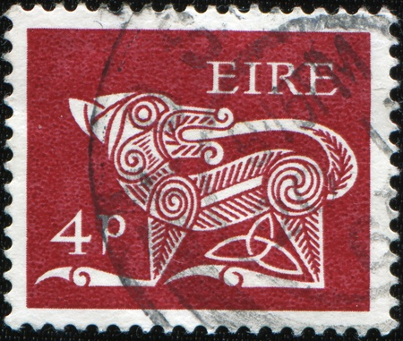 immortality: IRELAND - CIRCA 1978: A stamp printed in Ireland shows Dog Biting Tail - ancient Celtic symbol for renewal and immortality, circa 1978