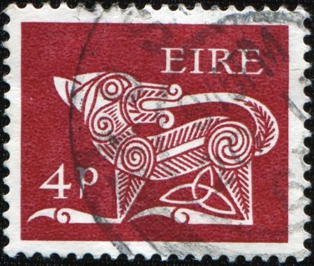 renewal: IRELAND - CIRCA 1978: A stamp printed in Ireland shows Dog Biting Tail - ancient Celtic symbol for renewal and immortality, circa 1978