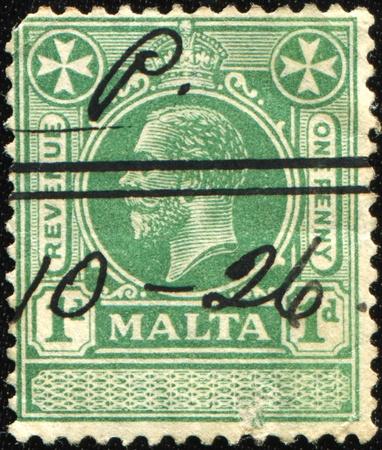 MALTA- CIRCA 1914  1920: A stamp printed in Malta shows image of King George V, circa 1914  1920