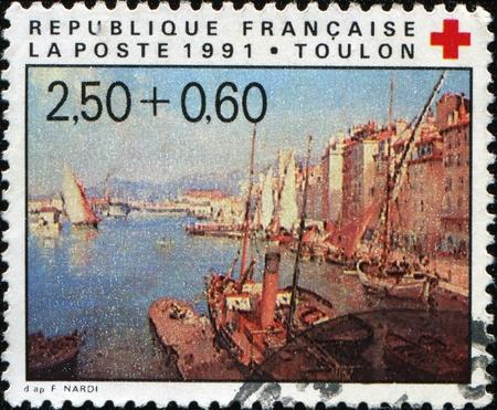 toulon: FRANCE - CIRCA 1991: A stamp printed in France shows Toulon wiev, circa 1991 Stock Photo