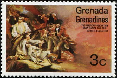 GRENADA - CIRCA 1976: A stamp printed in Grenada honored Battle of Bunker Hill in the American Revolutionary War, circa 1976 photo