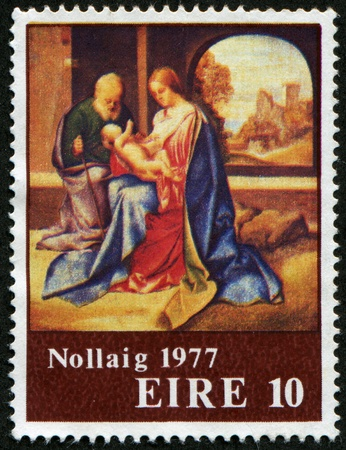 IRELAND - CIRCA 1977: A greeting Christmas postage stamp printed in Ireland shows Holy Family, circa 1977 Stock Photo - 8499019