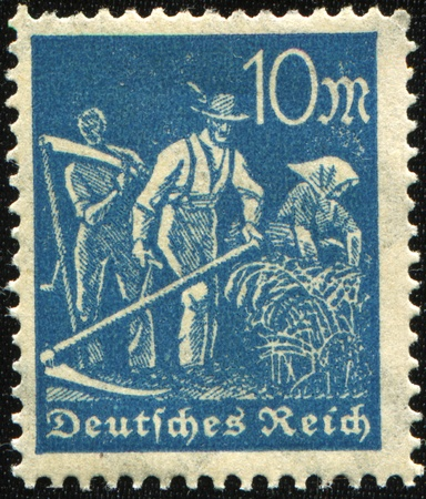 reich: German Reich - CIRCA 1930s: Airmail Stamp printed in German Reich shows farmers to harvest, circa 1930s