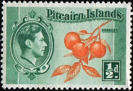 pitcairn: PITCAIRN ISLANDS - CIRCA 1940: A stamp printed in Pitcairn Island shows oranges, circa 1940 Stock Photo
