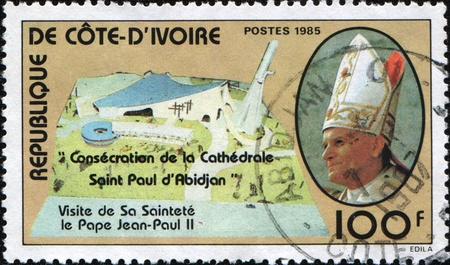 nobel: COTE DIVOIRE - CIRCA 1985: A stamp printed in Republic Cote dIvoire shows Pope John-Paul II, circa 1985