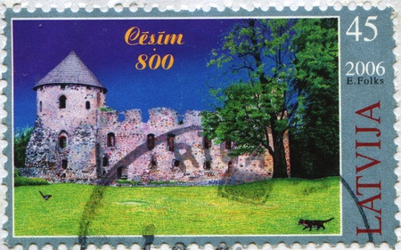 gauja: LATVIA - CIRCA 2006: A post stamp printed in Latvia shows Cesis Castle, circa 2006 Stock Photo