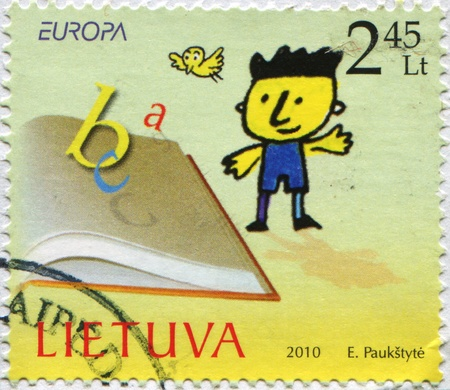 LITHUANIA - CIRCA 2010: A stamp printed in Lithuania shows boy standing beside an open book, circa 2010 photo