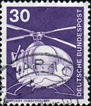FEDERAL REPUBLIC OF GERMANY - CIRCA 1979: A stamp printed in the Federal Republic of Germany shows ambulance helicopter, series, circa 1979  photo