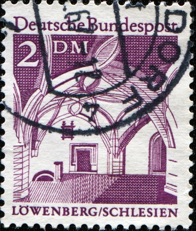 GERMANY - CIRCA 1966: A stamp printed in Germany shows Lowenberg Architecture Schlesien Town Hall , circa 1966 Stock Photo - 8578354