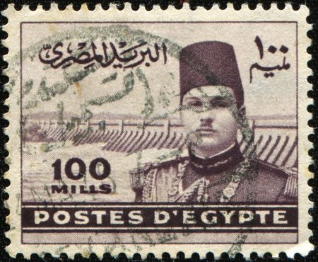farouk: EGYPT - CIRCA 1939-1946: A stamp printed in Egipt shows Farouk I of Egypt and Aswan Dam, circa 1939-1946 Editorial