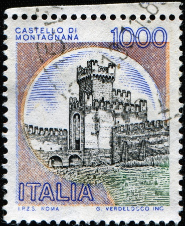 ITALY - CIRCA 1989: A stamp printed in Italy shows image of Montagnana Castle, series, circa 1989 Stock Photo - 8578366