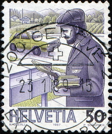 reins: SWITZERLAND - CIRCA 1987: A stamp printed in Switzerland shows postman with letters near postboxes, his car on the background, circa 1987