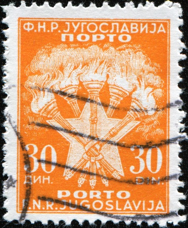 yugoslavia federal republic: YUGOSLAVIA - CIRCA 1950: A stamp printed in Yugoslavia shows five torches symbolizing the brotherhood of five nations: Serbs, Croats, Slovenes, Macedonians and Montenegrins, circa 1950