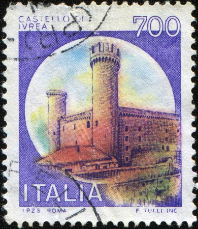 ITALY - CIRCA 1980: A stamp printed in Italy shows the castle which is located in Ivrea in Piedmont, Turin. The castle was built in 1358 by order of Amedeo VI of Savoy for defense purposes. From 1750 to 1970 was used as a prison. Stock Photo - 8681955