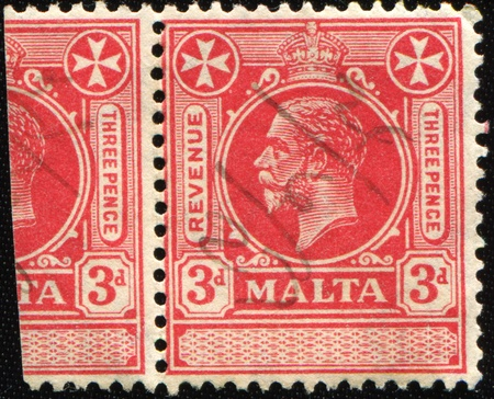 overprint: MALTA- CIRCA 1914  1920: A stamp printed in Malta shows image of King George V, circa 1914  1920