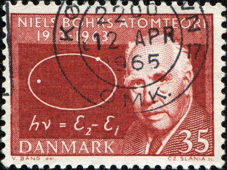 nobel: DENMARK - CIRCA 1963: A stamp printed in Denmark shows image of Niels Bohr, celebrating the fiftieth anniversary of his famous atomic theory, circa 1963