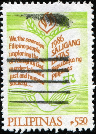 imploring: PHILIPPINES CIRCA 1986: A stamp printed in Philippines shows Constitution of Philippines, circa 1986