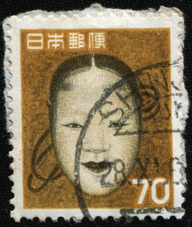 JAPAN - CIRCA 1965: A stamp printed in Japan shows female mask Noh, circa 1965 photo