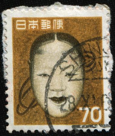 sidelit: JAPAN - CIRCA 1965: A stamp printed in Japan shows female mask Noh, circa 1965