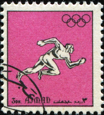 AJMAN - CIRCA 1967: A stamp printed in emirate Ajman show runer, series honoring 1968 Summer Olympic Games - Mexico City, Mexico circa 1967