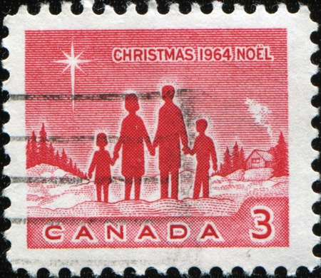 CANADA - CIRCA 1964: A stamp printed in Canada shows Family and Star of Bethlehem, circa 1964 photo